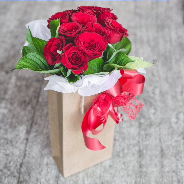 12 Red Roses In Craft Paper Bag Auckland Flowers