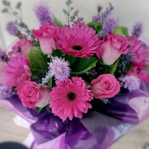 Pink And Purple Flowers Bouquet In Water Filled Box