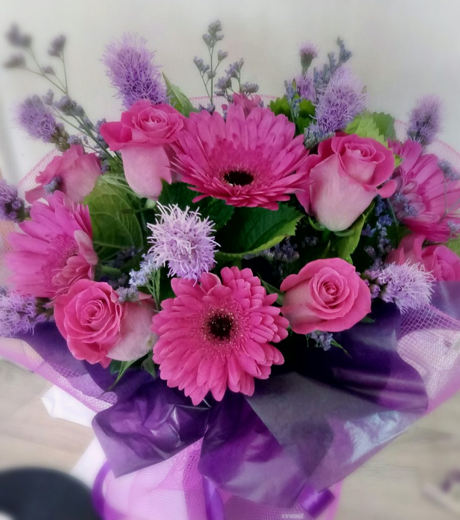 Pink and purple flowers bouquet in water filled box auckland flowers pink and purple bouquet izmirmasajfo